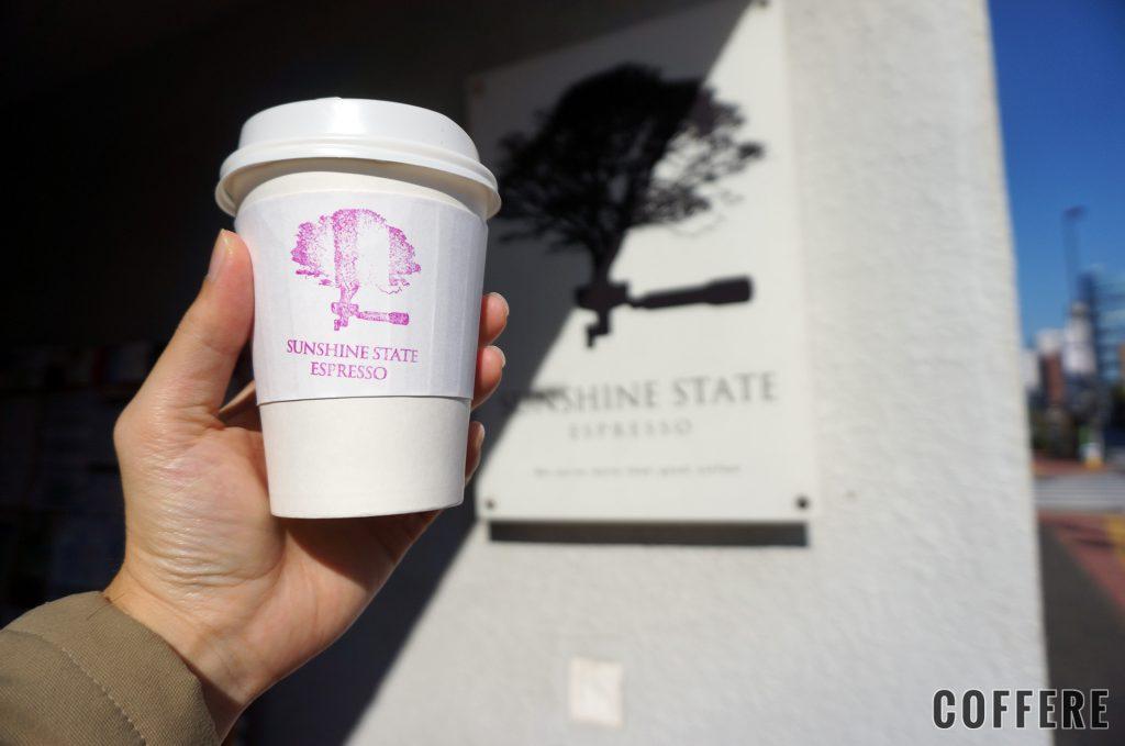 SUNSHINE STATE ESPRESSOのカップと外のロゴ
