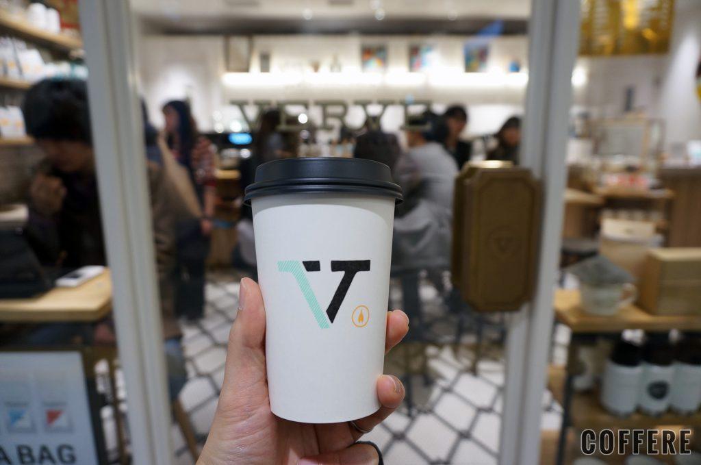 hand with VERVE COFFEE ROASTERS coffeecup